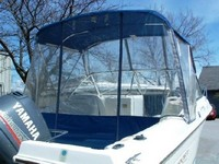 Photo of Aquasport 215 Dual Console, 1996: Bimini-Top, Bimini Connector, Side-Curtains, Aft-Drop-Curtain, viewed from Starboard, Rear