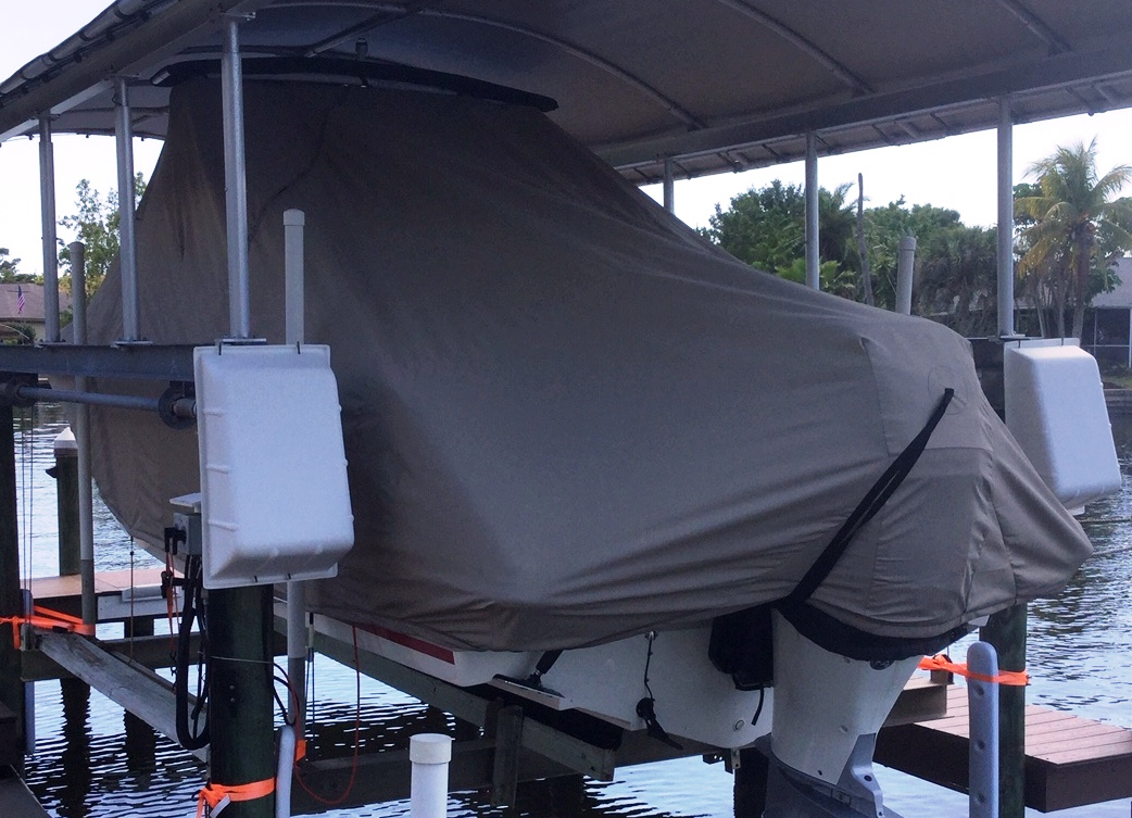 Boston Whaler Vantage 230 Tower, 20xx, TTopCovers™ T-Top boat cover On Lift, port rear