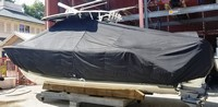 Photo of Cobia® 320CC 20xx T-Top Boat-Cover, viewed from Port Rear