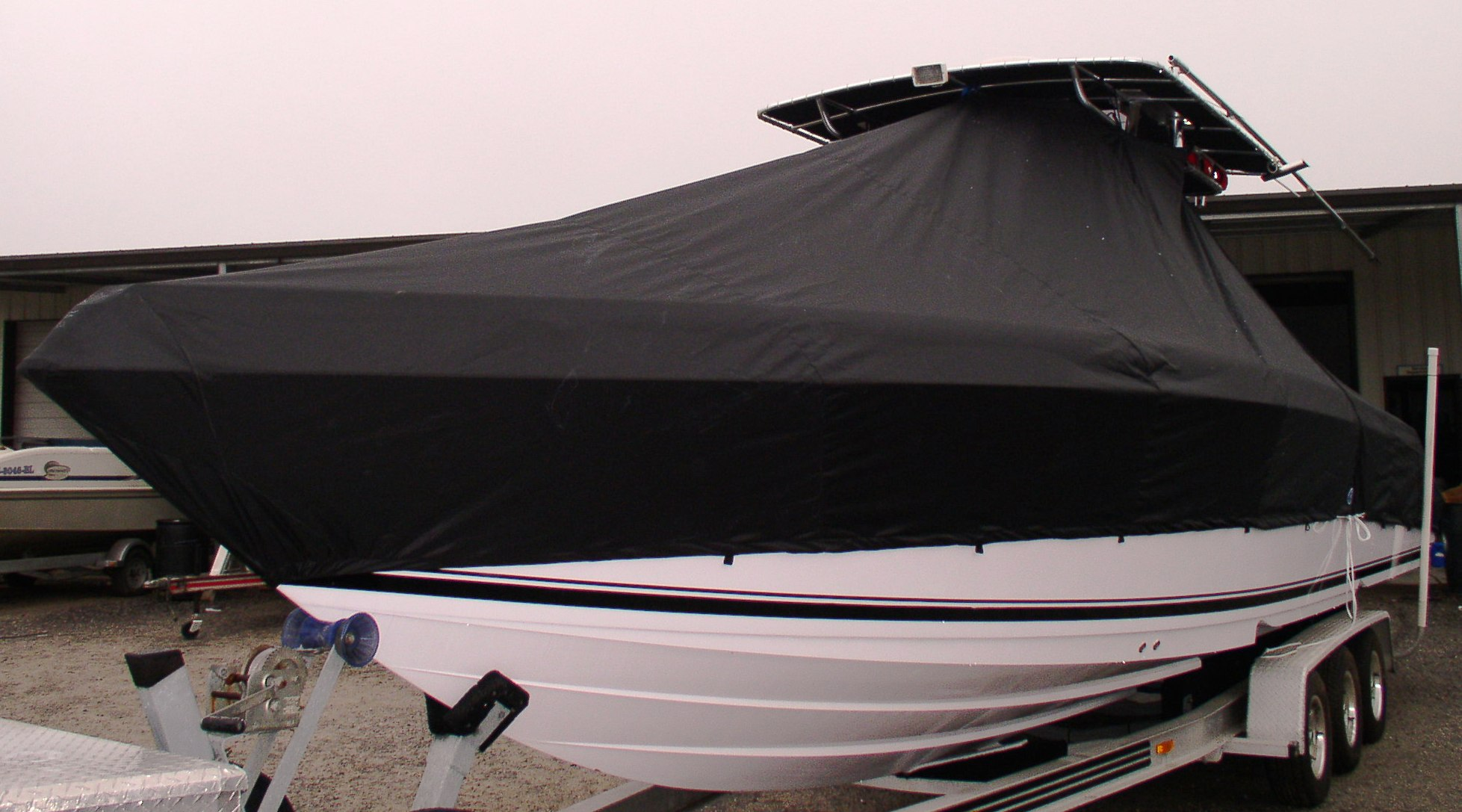 Donzi 32 ZF Open, 20xx, TTopCovers™ T-Top boat cover, port front