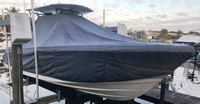 Photo of Edgewater 262CC 20xx T-Top Boat-Cover On Lift (recommend 6 8 Sand Bags), viewed from Starboard, Front