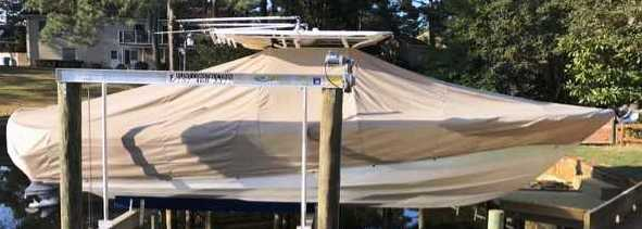 Edgewater 318CC, 20xx, TTopCovers™ T-Top boat cover On Lift (recommend 8 Sand Bags), starboard side