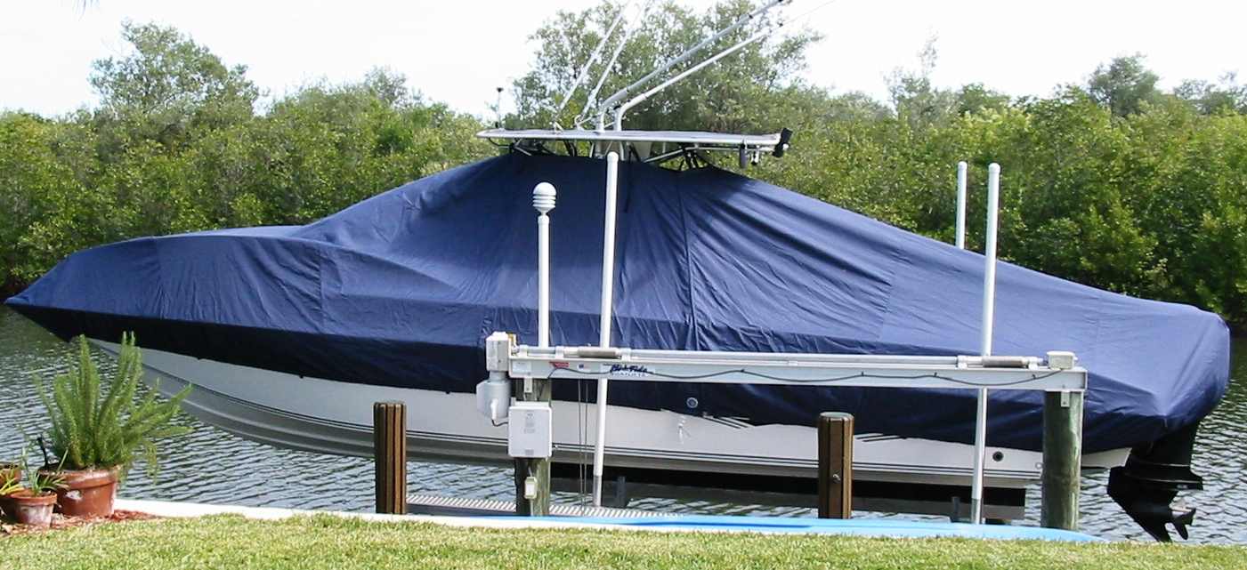 Fountain 31CC, 20xx, TTopCovers™ T-Top boat cover On Lift, starboard side