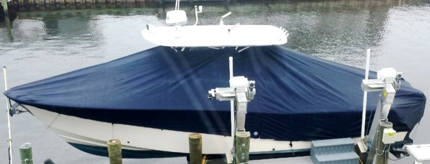 Grady White Bimini 306, 19xx, TTopCovers™ T-Top boat cover On Lift, starboard side