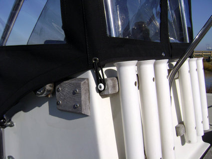 Montauk-T-Topless™ Spray-Shield and Gull-Wings Bungee Balled to Montauk 17's Front Rod Holders Picture