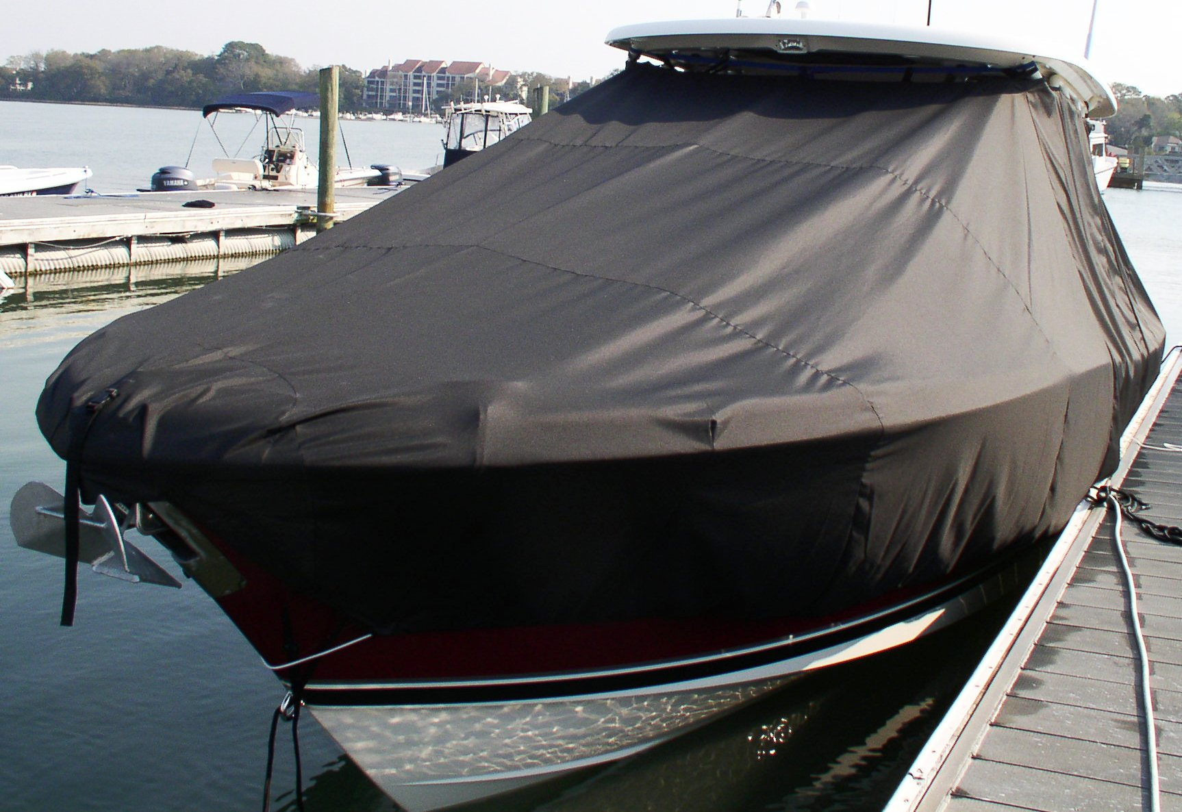 Pursuit S 310, 20xx, TTopCovers™ T-Top boat cover in Water, port front