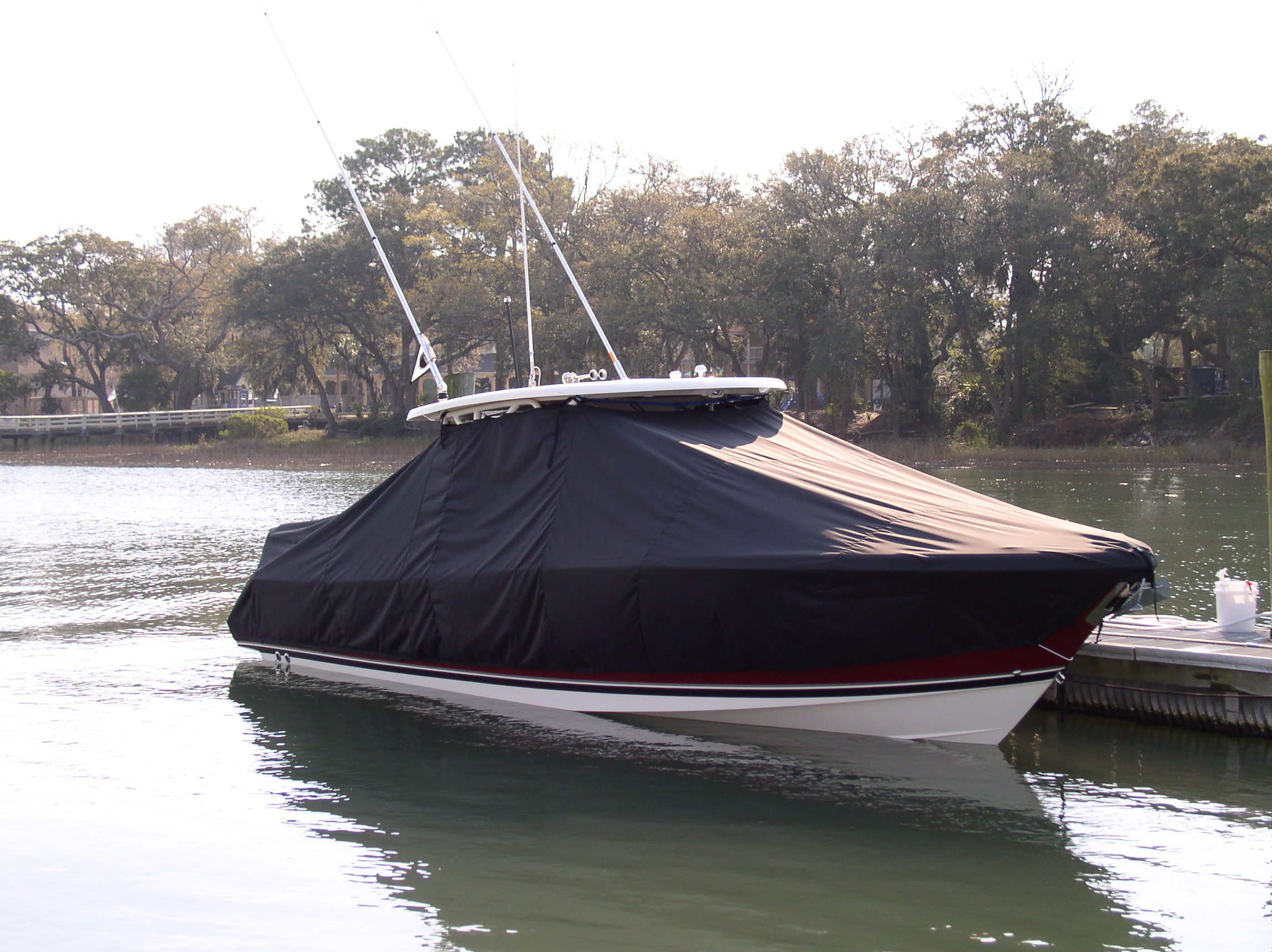 Pursuit S 310, 20xx, TTopCovers™ T-Top boat cover in Water, starboard front