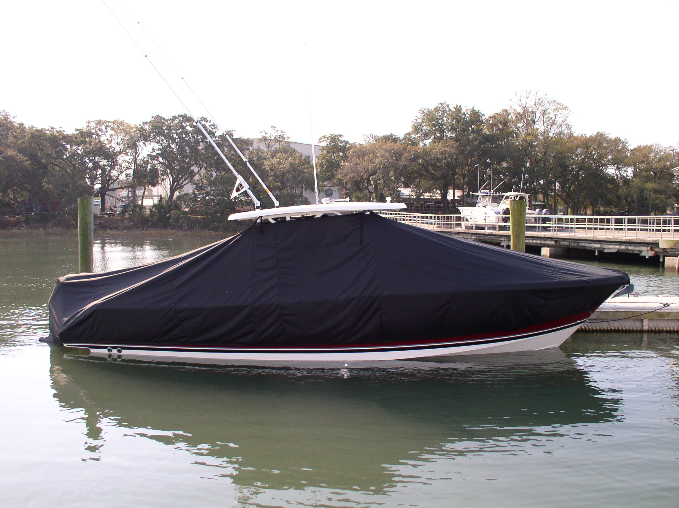 Pursuit S 310, 20xx, TTopCovers™ T-Top boat cover in Water, starboard side