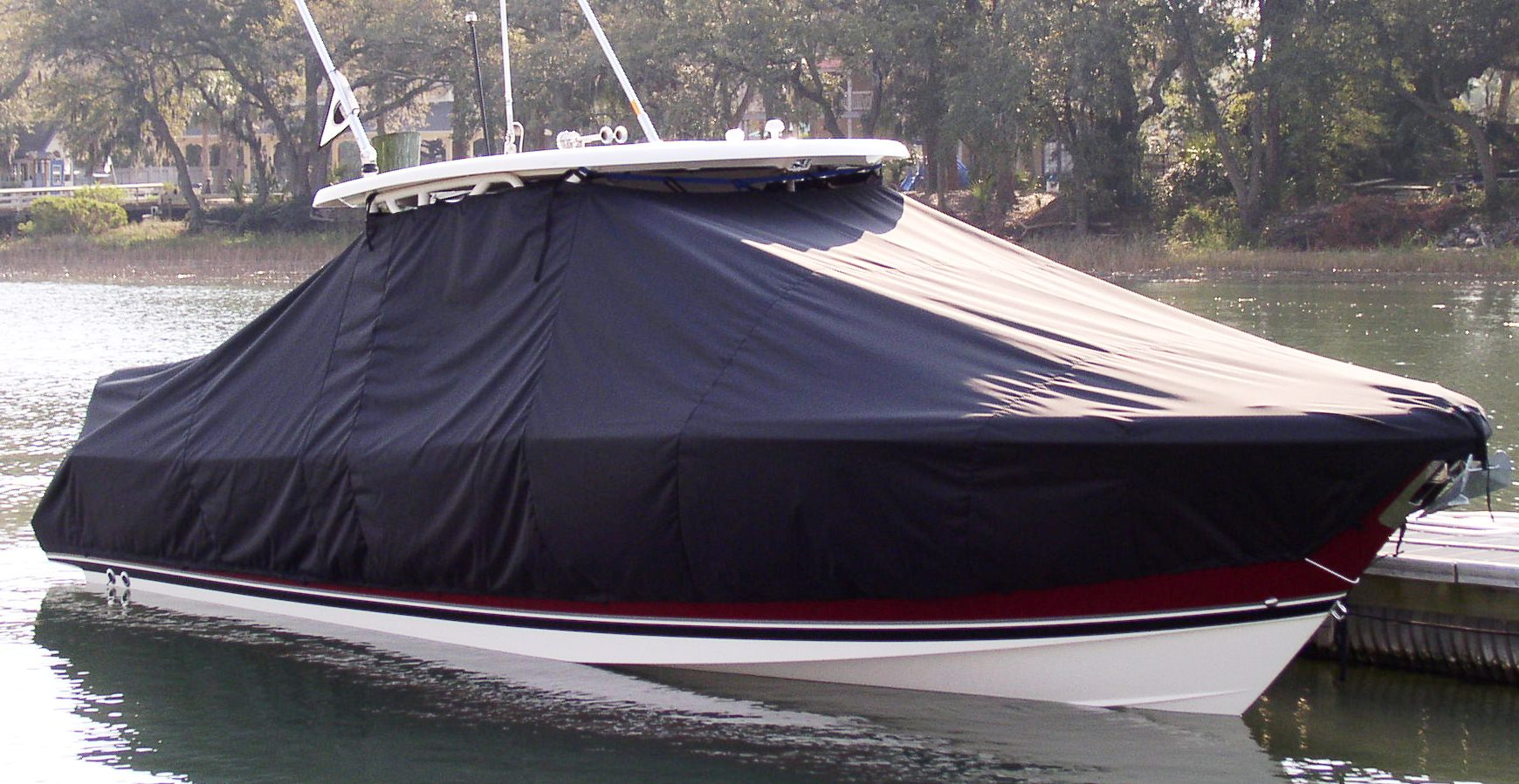 Pursuit ST 310 Sport, 20xx, TTopCovers™ T-Top boat cover in Water, starboard front