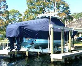 Regulator 34FS, 20xx, TTopCovers™ T-Top boat cover on Lift, starboard rear