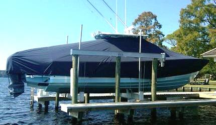 Regulator 34FS, 20xx, TTopCovers™ T-Top boat cover on Lift, starboard side