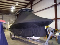 Photo of Sea Hunt® Triton-232 20xx T-Top Boat-Cover Extended Skirts, viewed from Starboard Front