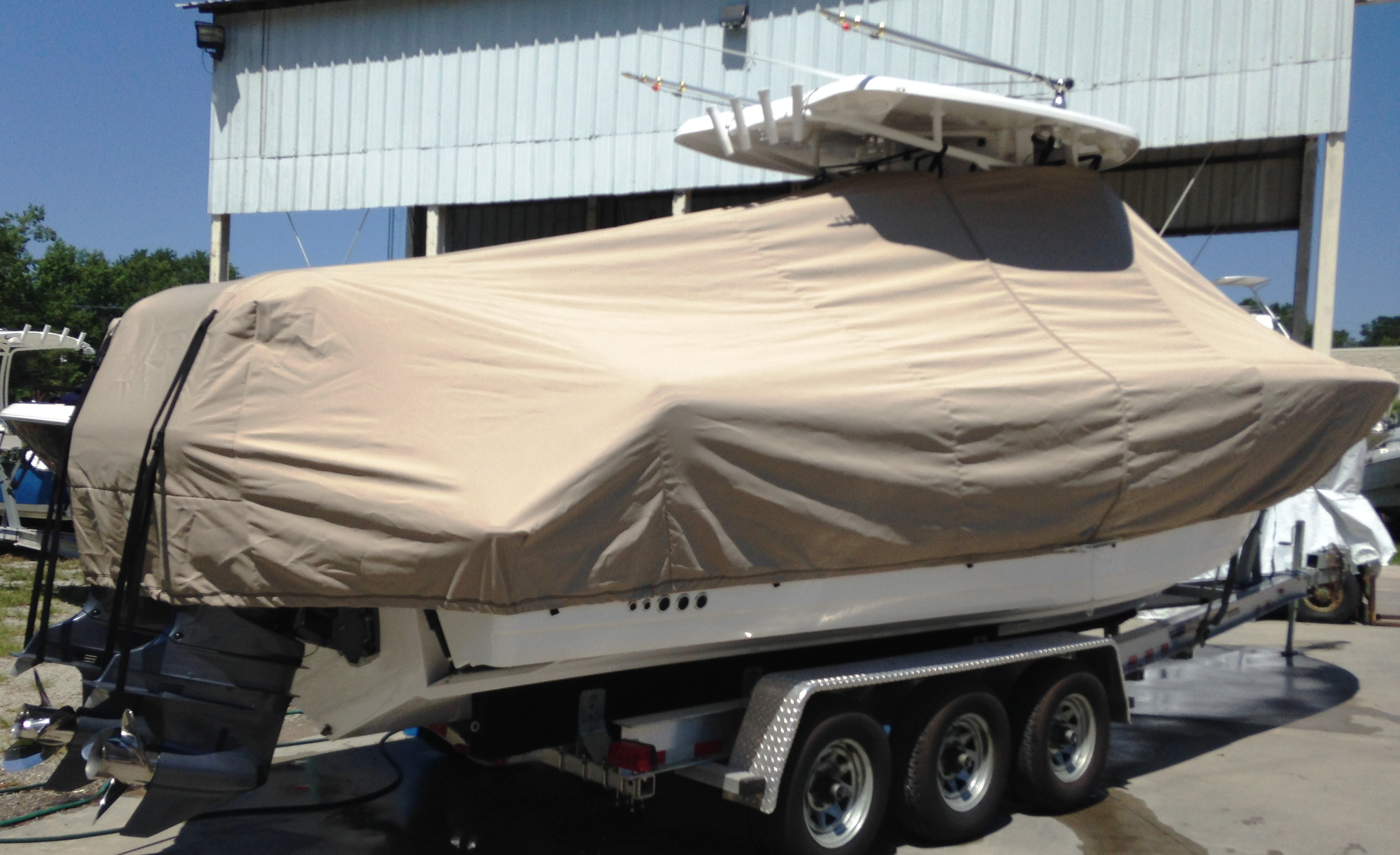 Tidewater 280CC, 20xx, TTopCovers™ T-Top boat cover with optional Aft Motor Tie Down Loops and Straps, starboard rear