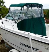 Photo of Trophy 2302 WA, 2004: Bimini Top, Front Connector, Side Curtains, Aft-Drop-Curtain, viewed from Starboard Rear