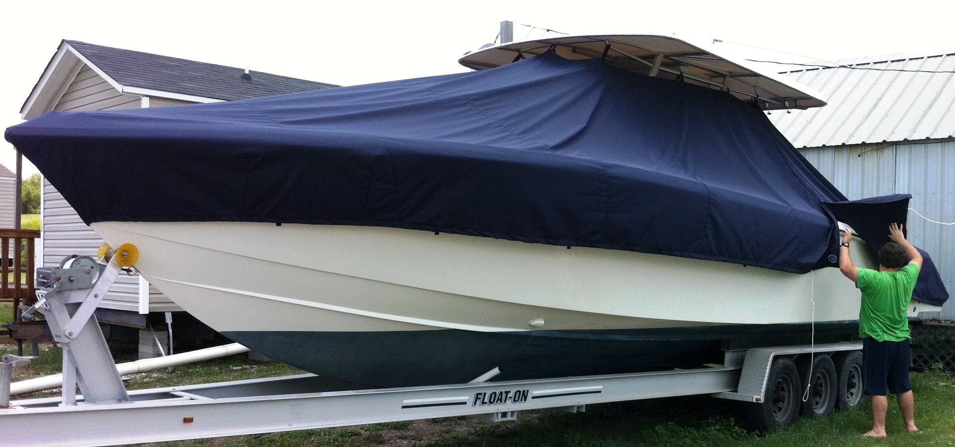 Venture 34CC, 20xx, TTopCovers™ T-Top boat cover, port front
